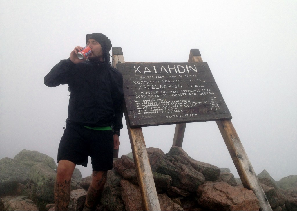 Enjoying a Moxie on top of Katahdin.