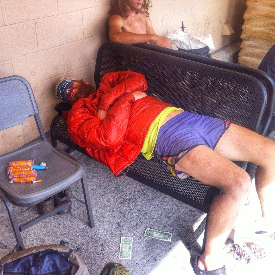 bench sleeping and dollar bills