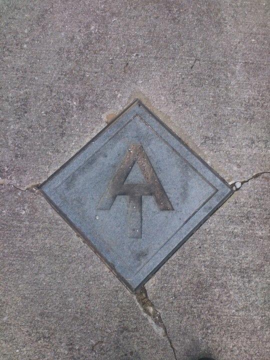 AT symbol Hot Springs sidewalk