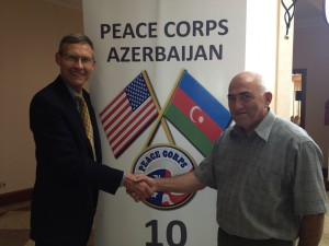 Robert, left, completed  three months of intensive language Pre-Service Training in Sumgayit, Azerbaijan.   Robert is being congratulated after being sworn into the U.S. Peace Corps as an Economic Development Advisor.