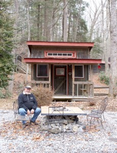 Bob Breuer rests outside of a cabin at Black Bear Resort. He said the fire pit is a 'hot spot' for guests to get to know each other. (Photo by Kayla Carter)