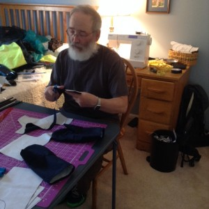 Mel making waterproof, breathable mittens to go over our wool mittens.