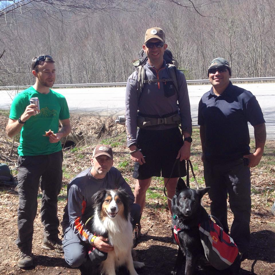 "This is a group of some section and some thru-hikers who came through our trail magic with their two pups! Really cool guys. We heard later that they were very surprised by our ""trail magic"" and were telling everyone up the trail about how they couldn't believe they were just walking in the woods and someone handed them pizza and beer!"