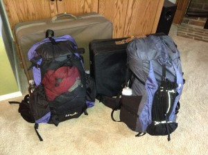Cheap suitcases to protect backpacks as check-in luggage.