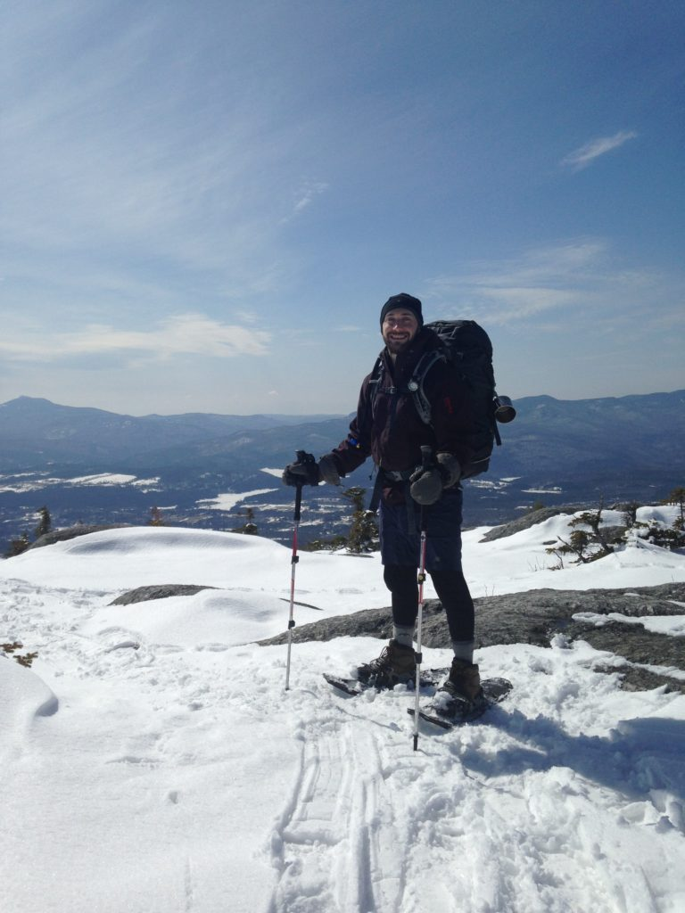 Kyler at the top of Hunger Mountain in Vermont. One of our practice hikes.