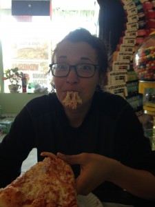 Chowing down on pizza in attempts to regain some lost lbs.