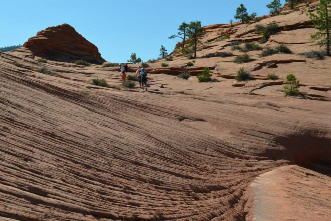 Hiking the red slick rock to get to the Subway in Zion.