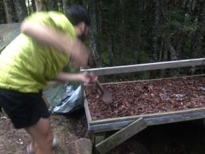 Shoveling shit....