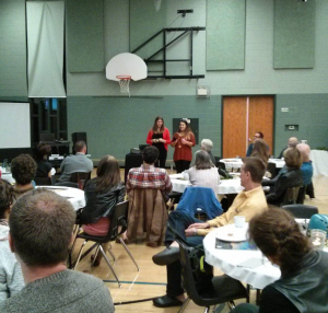 Victoria and I introducing Wally and Beav's hiking adventure at a Mountain Lodge information night.