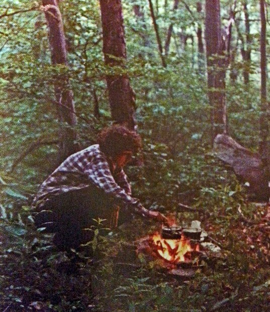 Dorothy Laker cooking over a campfire on the Appalachian Trail.