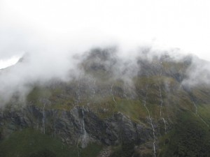 Waterflows flowing down a mountain above the Lake Mackenzie Hut.