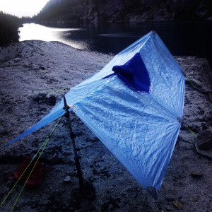 Breathable tarp/poncho. Set up as tarp with trekking poles