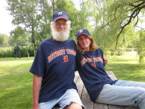 Charlie and Nancy (after losing a bet to a Detroit fan) at their home in Glencliff