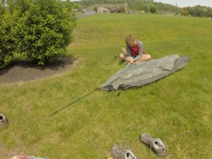 Working on our tent on a hotel lawn