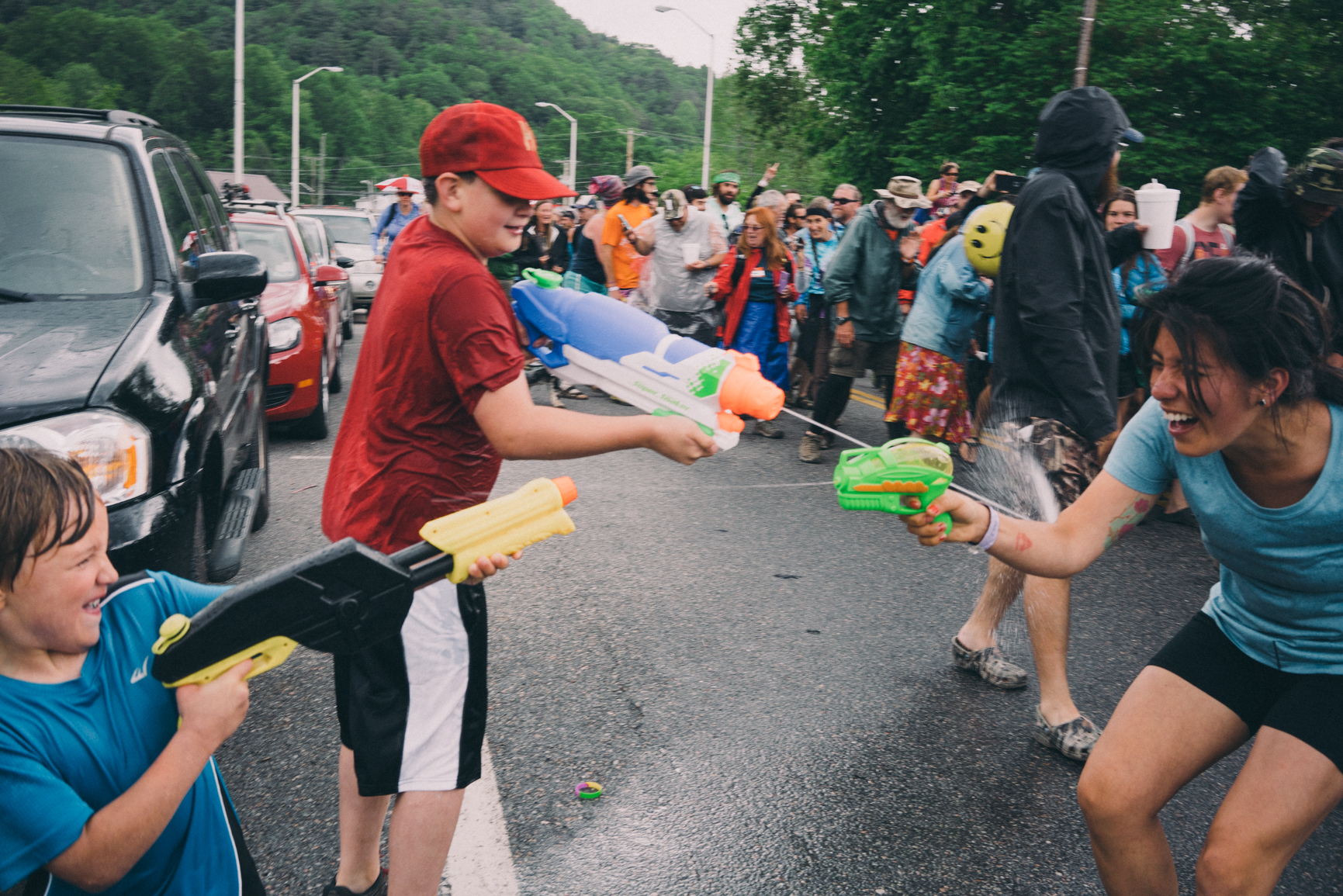 Hiker vs. Kid + Big Water Gun at the Hiker Parade.