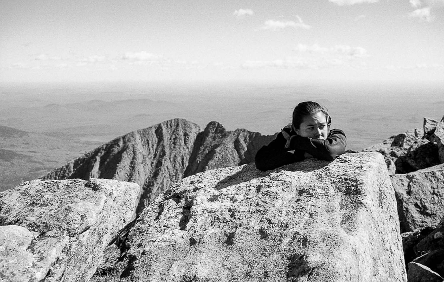 Pocahontas letting out some emotion on completing her thru-hike on top of Katahdin.