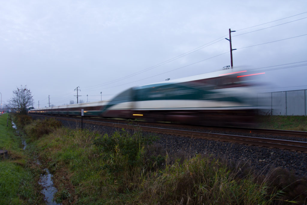 Blurred Amtrak train passing by