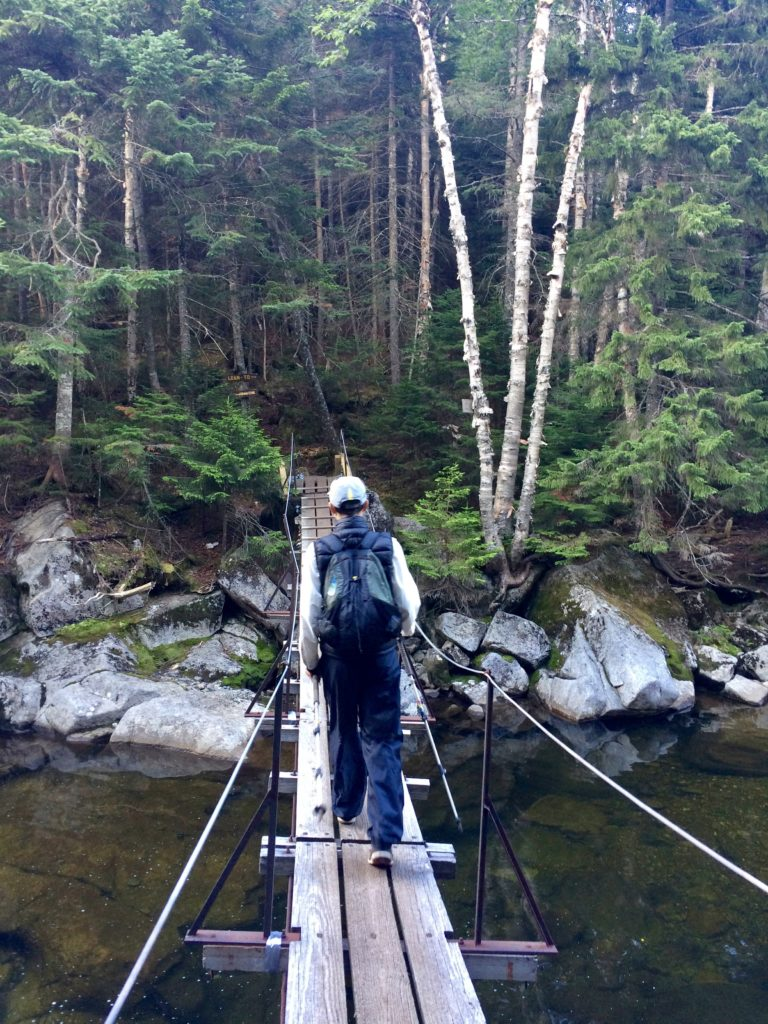 Crossing the suspension bridge over the Opalescent River.