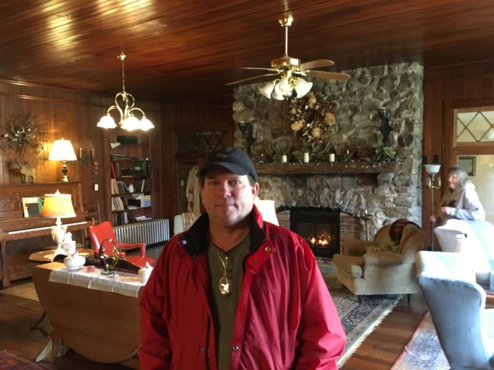 Jeff Hines, manager of Laughing Heart Hostel, Hot Springs NC, standing in the luxurious main room of the lodge