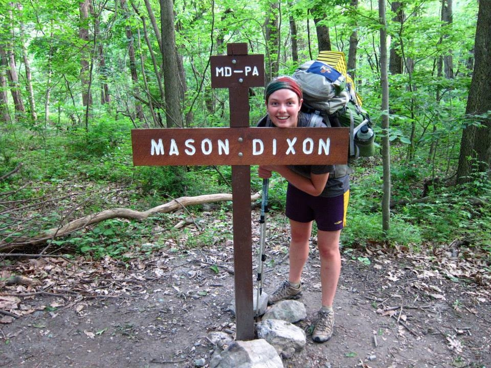 photo of thru-hiker on a thru hike at the Mason-Dixon Line
