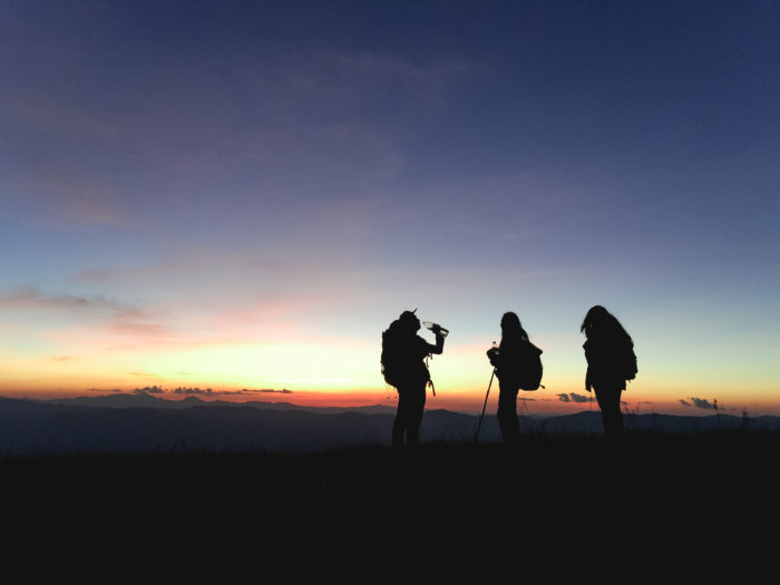 happy hikers sunset