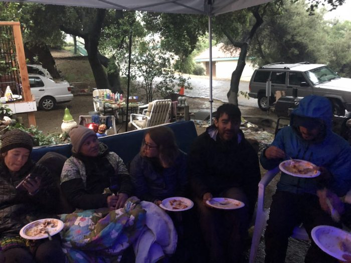 A photo of pct hikers eating taco salad