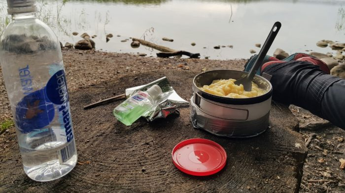 Mashed potatoes in a pot with a lake view.