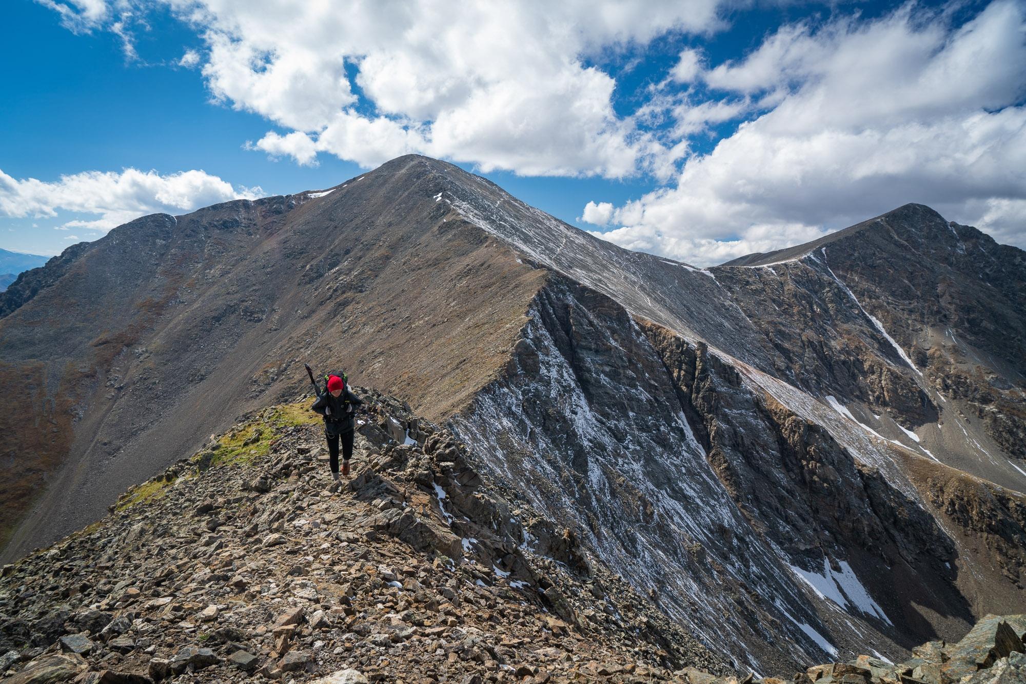 hiker hiking on a mountain ridge in Colorado
