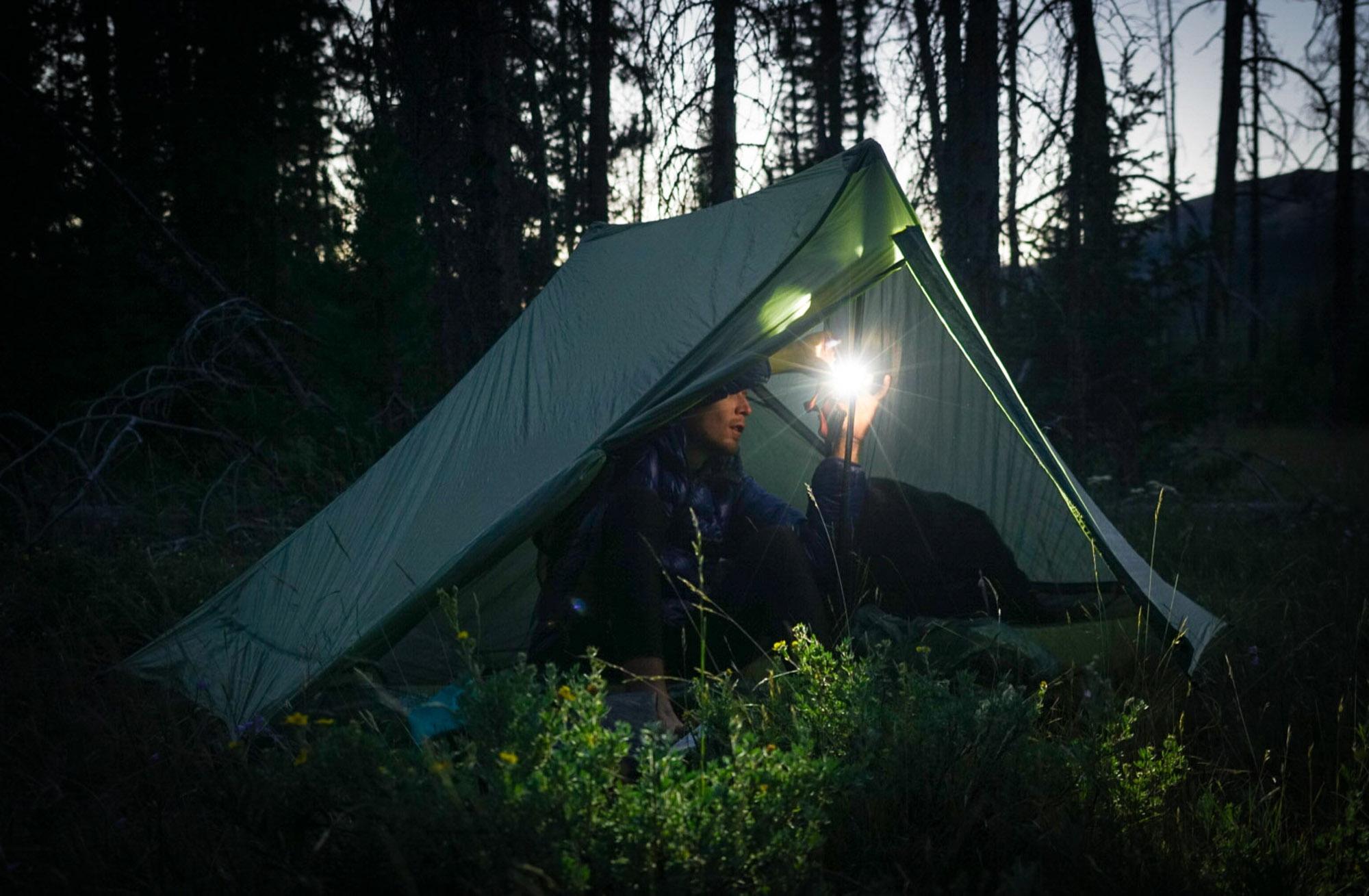 hiker inside gossamer gear tent