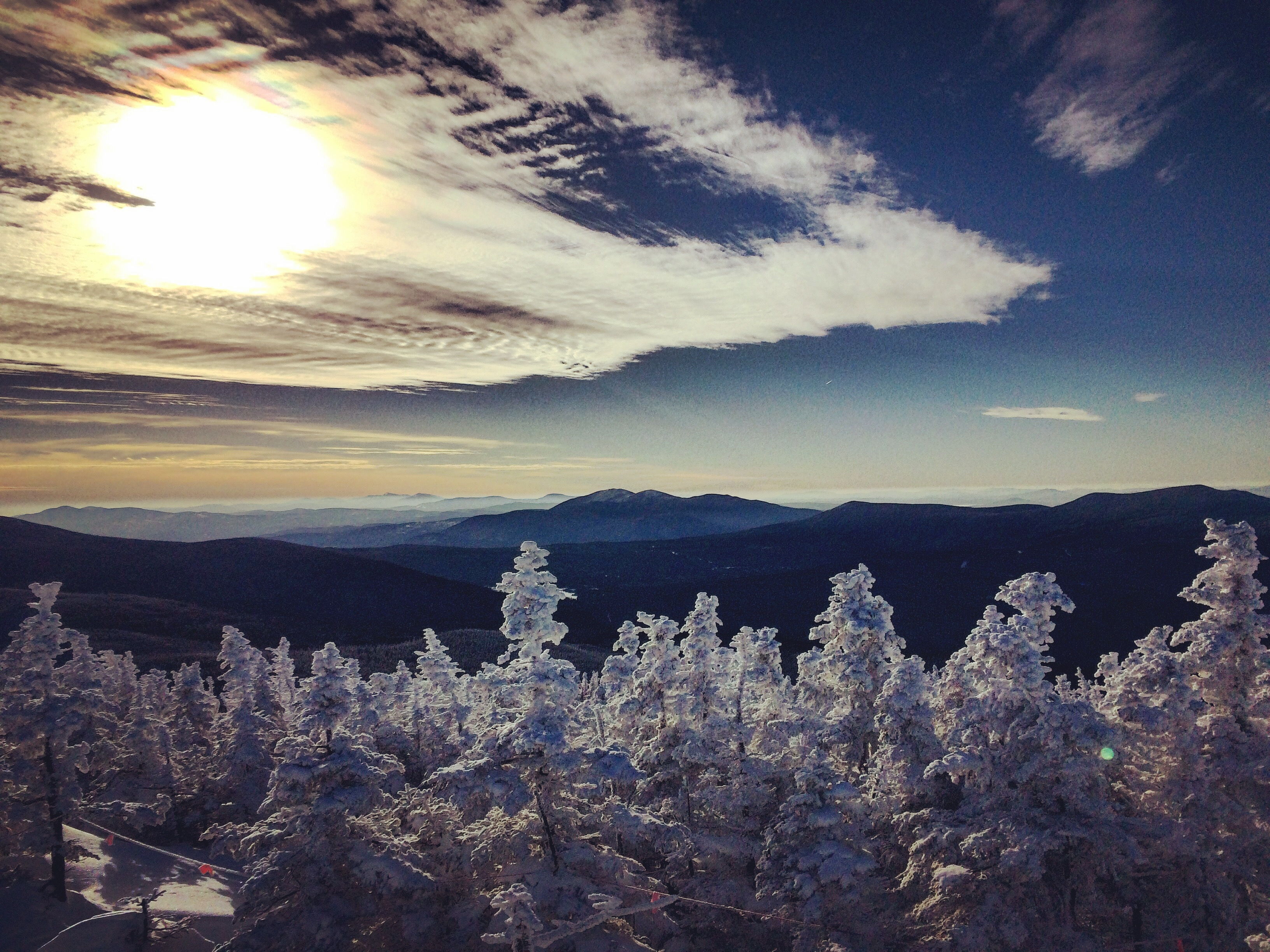 a photo overlooking mountains of Maine on Sugarloaf Mountain in winter