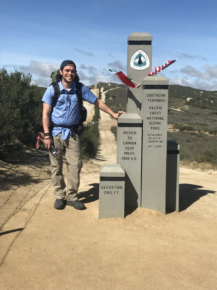 Benjain Martin Standing at the Southern terminus of the Pacific Crest Trail.