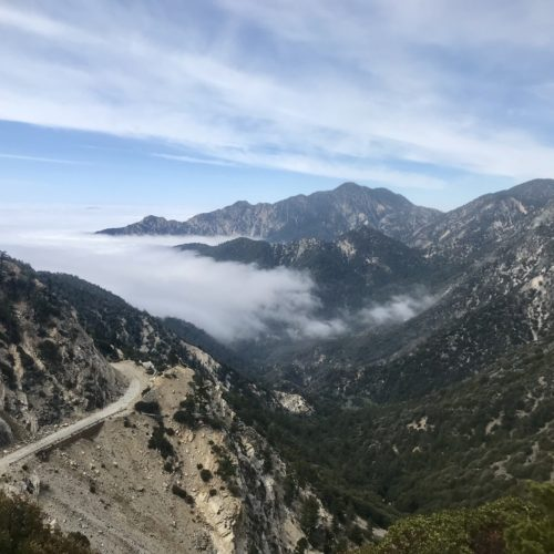 Picture of clouds pouring over the mountains near Wrightwood, CA.