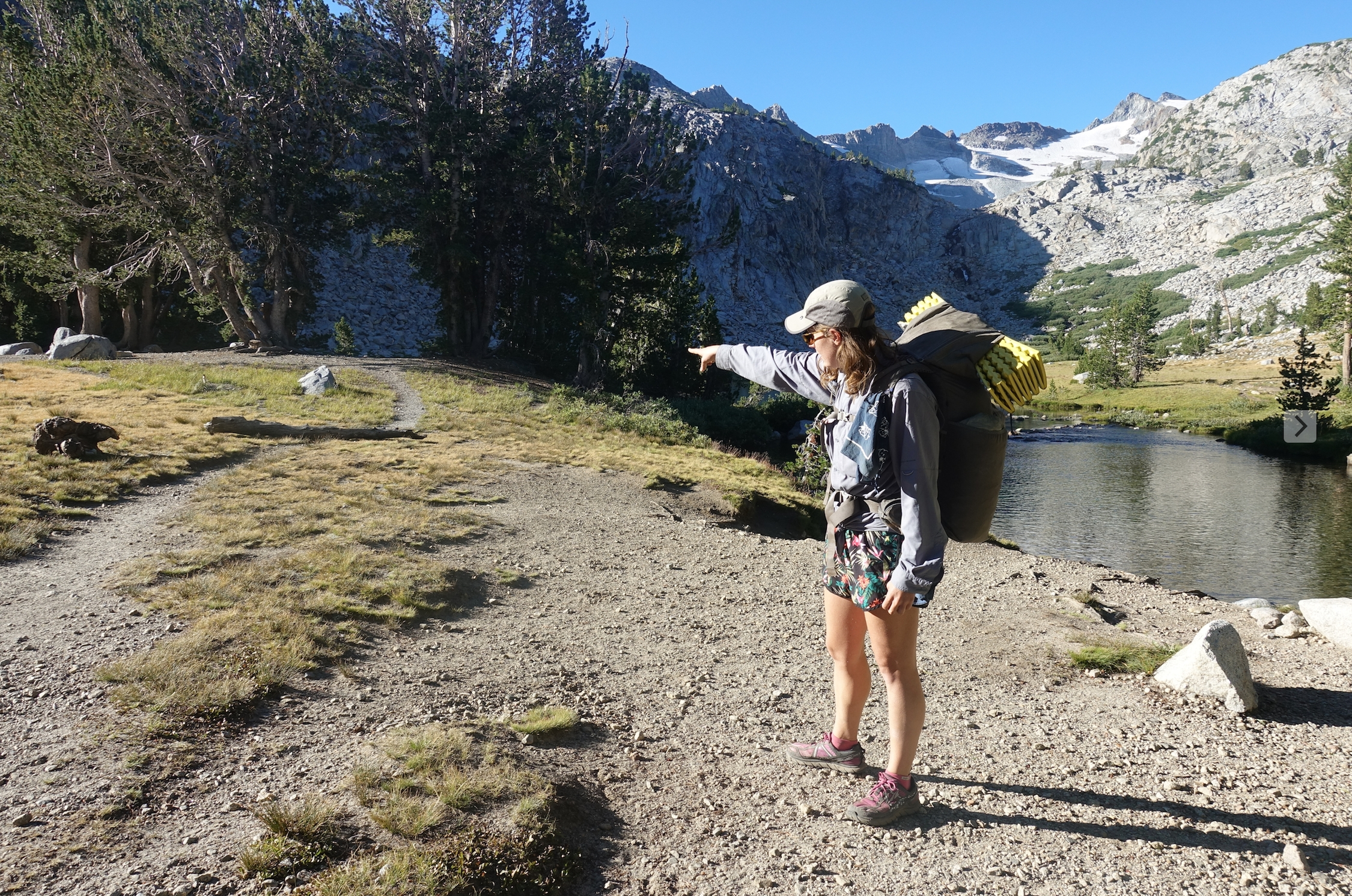 Tofu is on the JMT and pointing at the trail ahead.