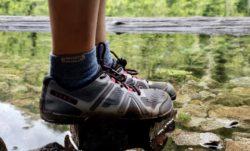 Xero Mesa Trail shoes balanced on a rock in a lake