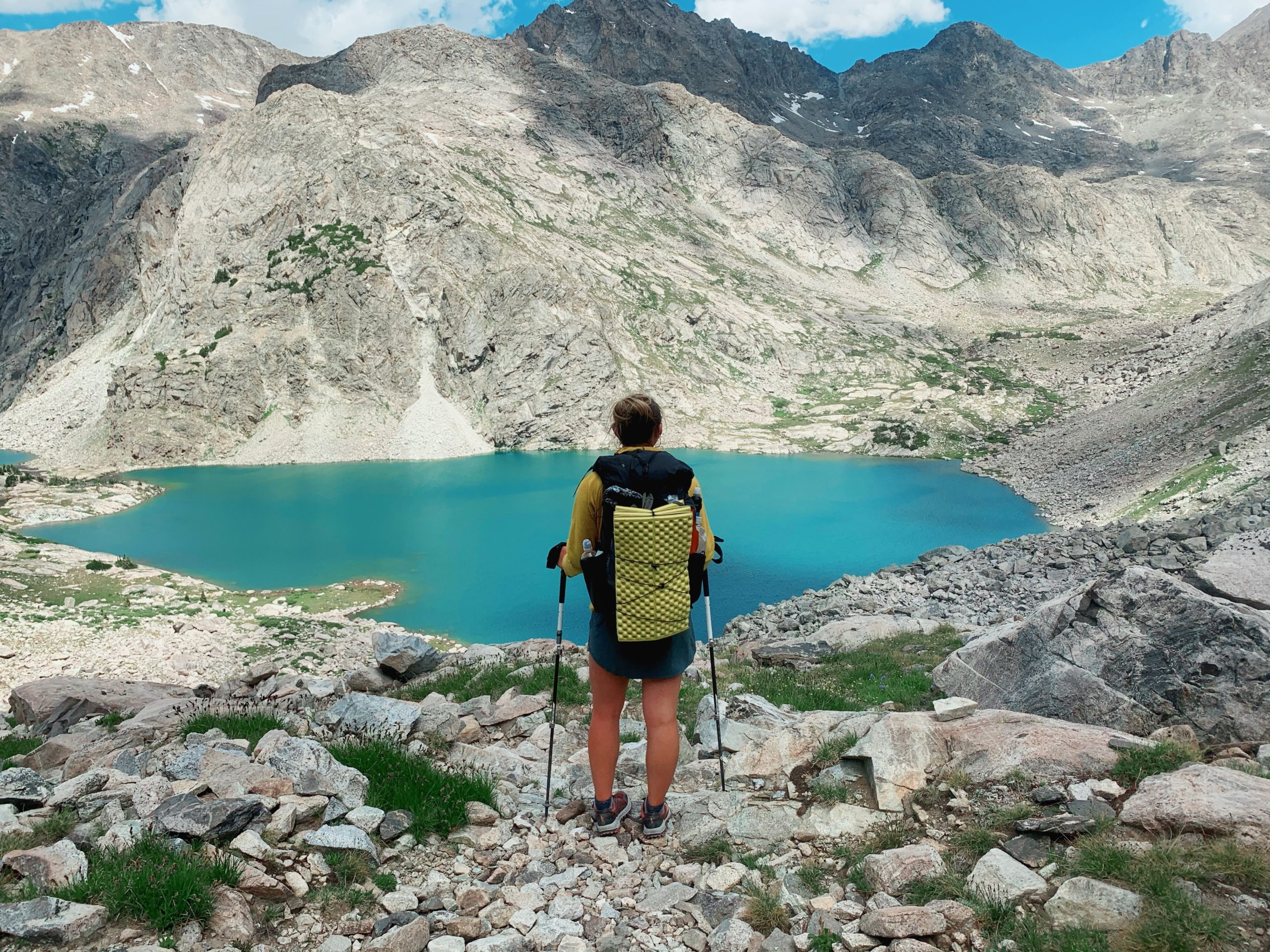 Standing in front of an alpine lake with a Superior Wilderness Designs Long Haul 40 Pack.