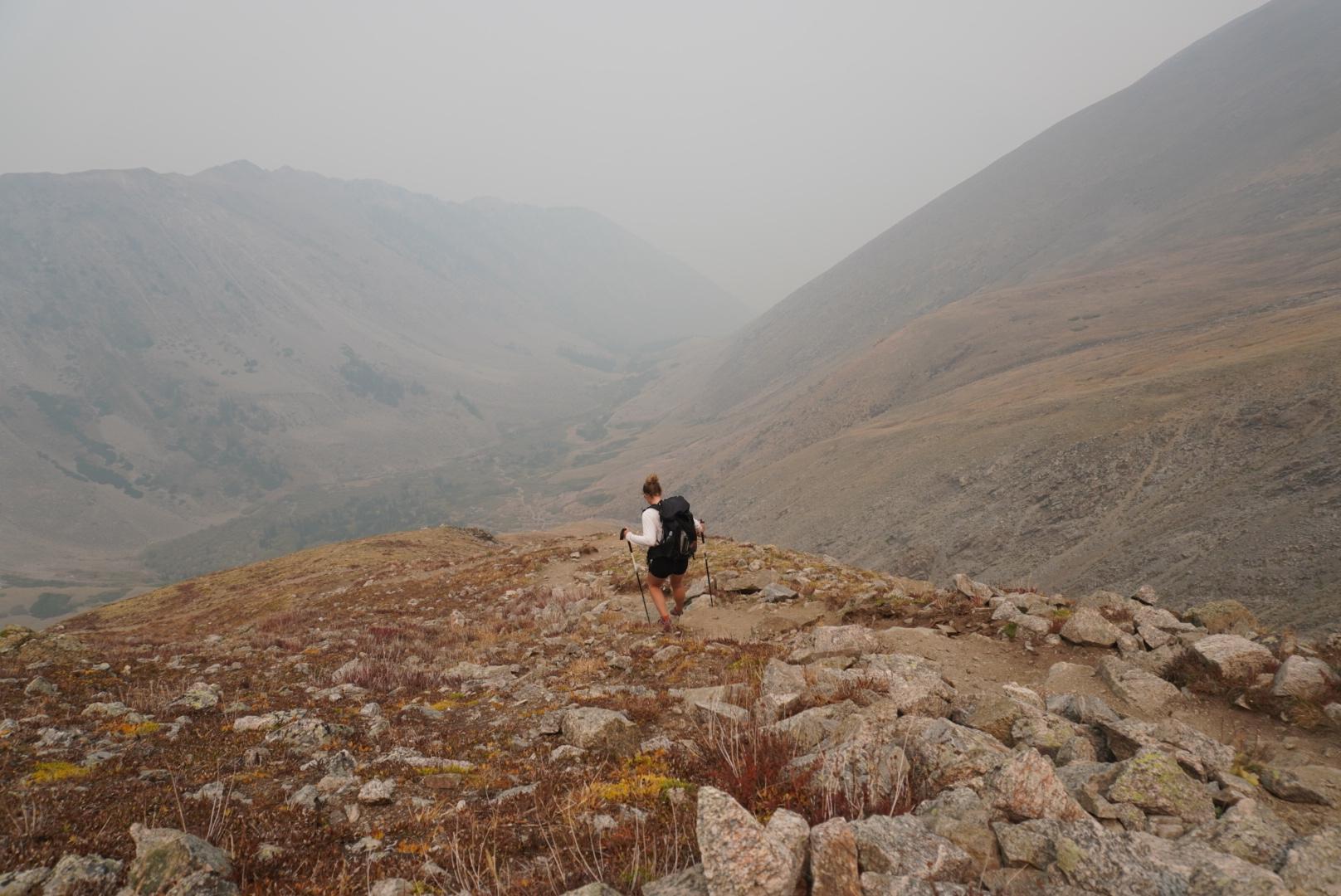 Descending a mountain as wild fire smoke rolls in.