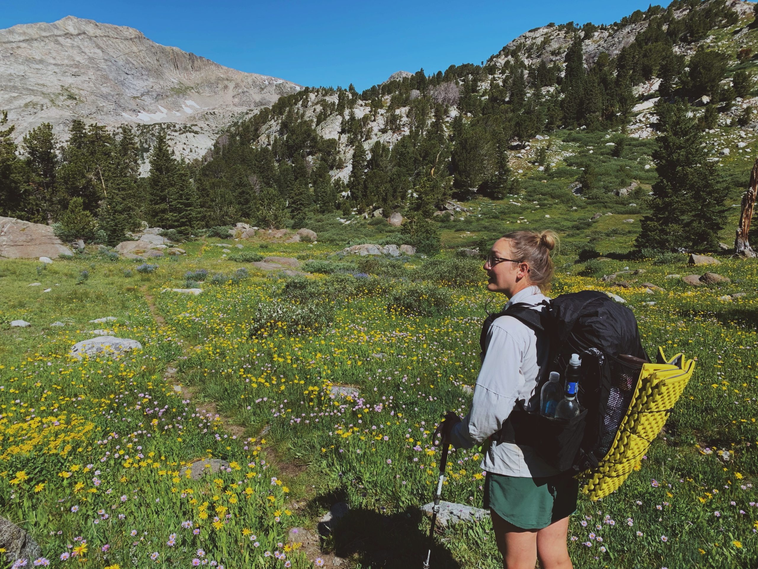 A woman on a trail wearing a Superior Wilderness Designs Long Haul 40 pack.