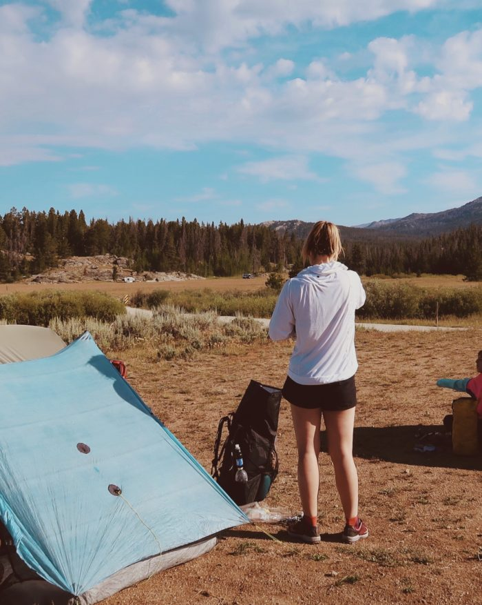 woman standing in campsite