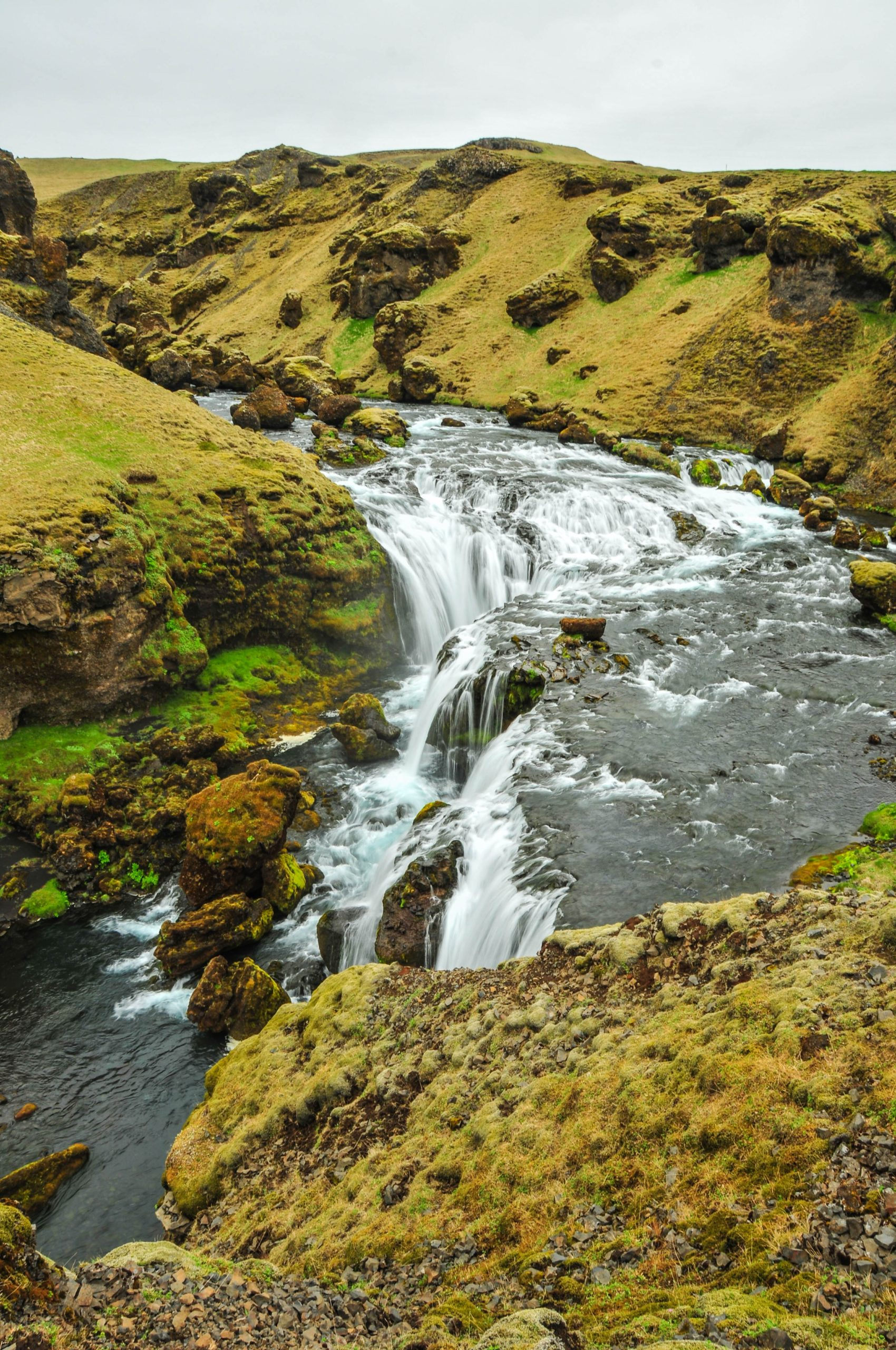 smaller waterfall and mountainous landscape above Skógafoss in southern Iceland