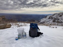 Picture of food cache hiking backpack after collecting a backcountry food cache