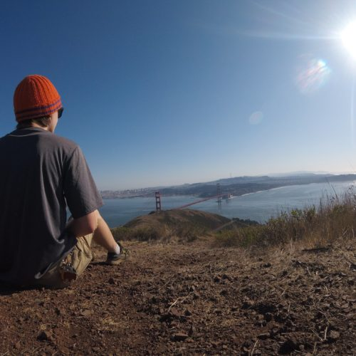 Sitting on hill near golden gate bridge
