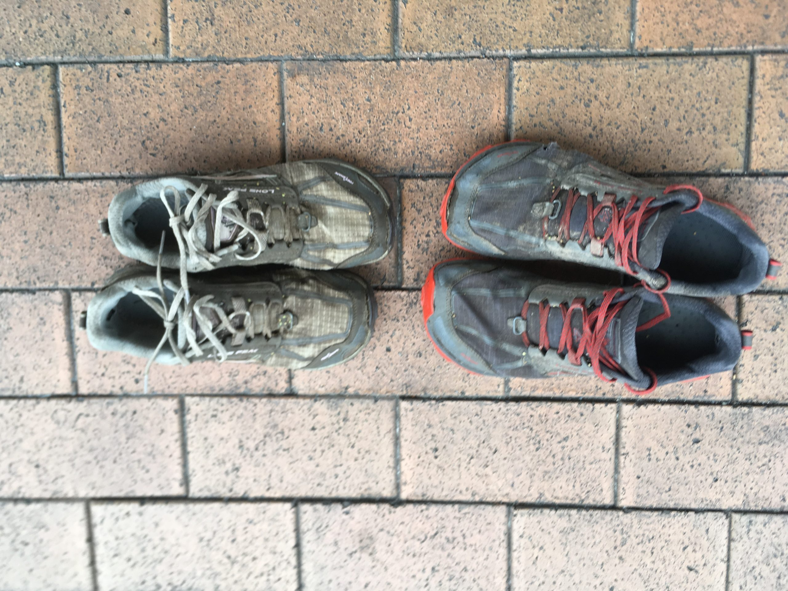 Used Hiking shoes on brick path