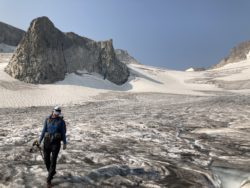 Hiker on galcier. Completing goal of Wind River High Route