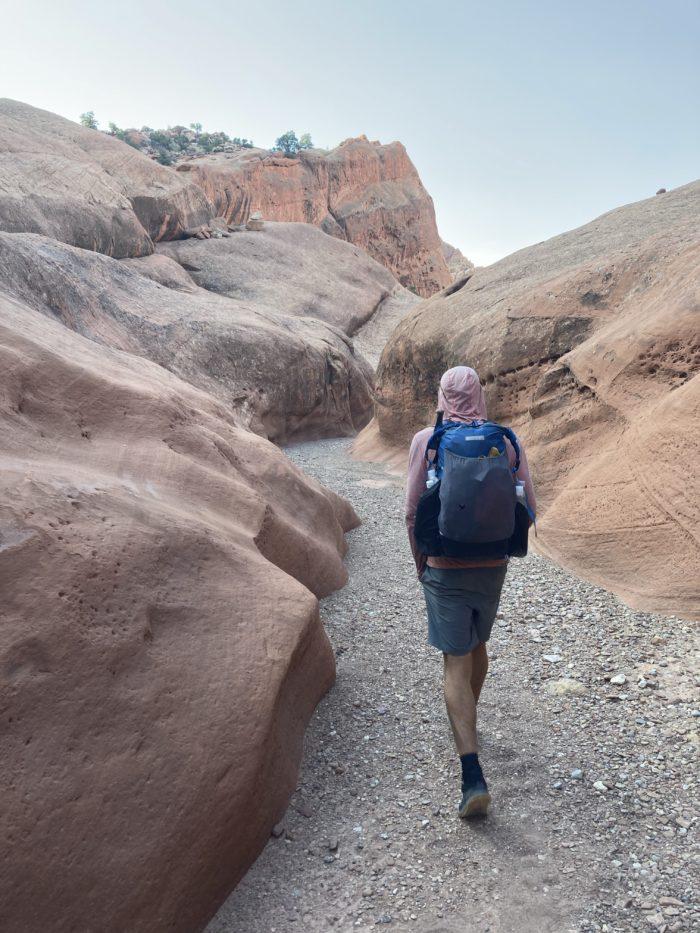 Hiker  walking through desert canyon