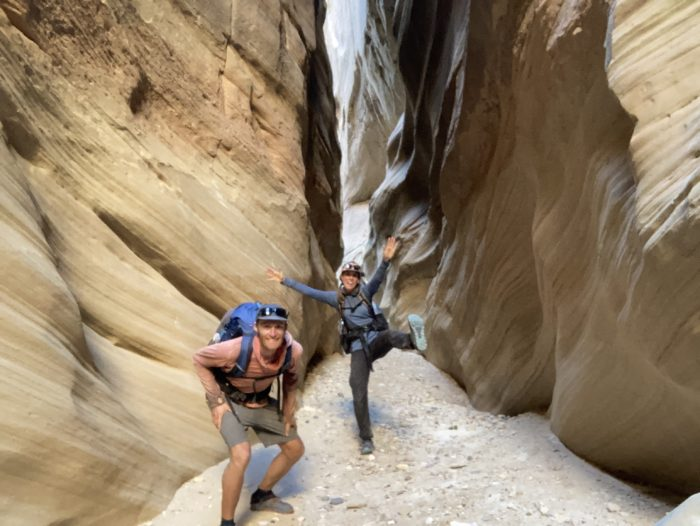 Two hikers in a slot canyon