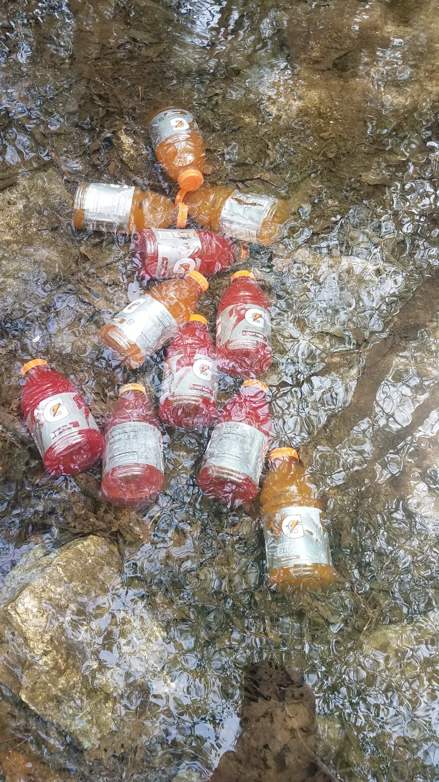 A cache of gatorades for hikers left in a stream
