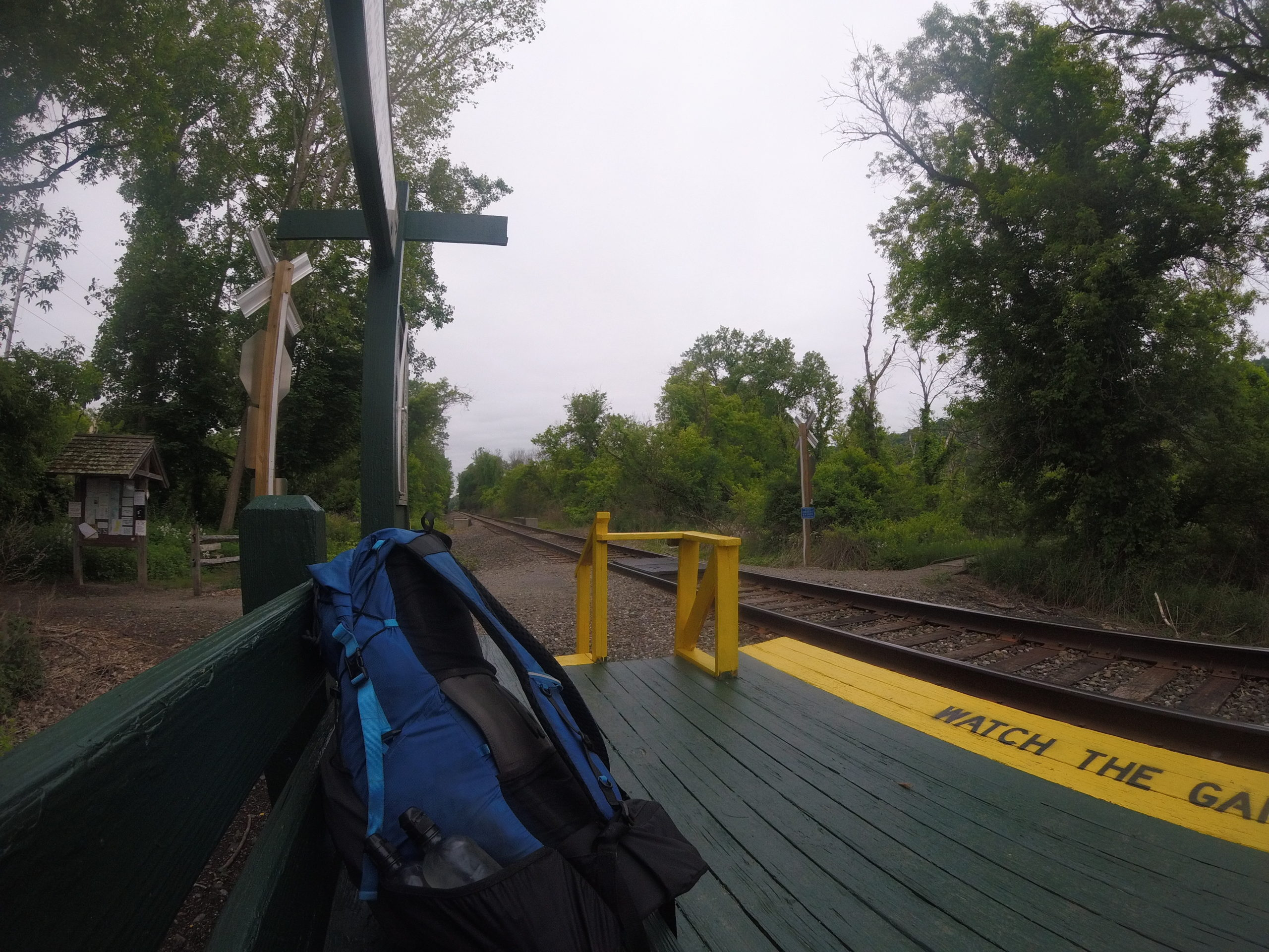 Blue backpack sits on bench at train station located in Pawling, NY on the Appalachian Trail