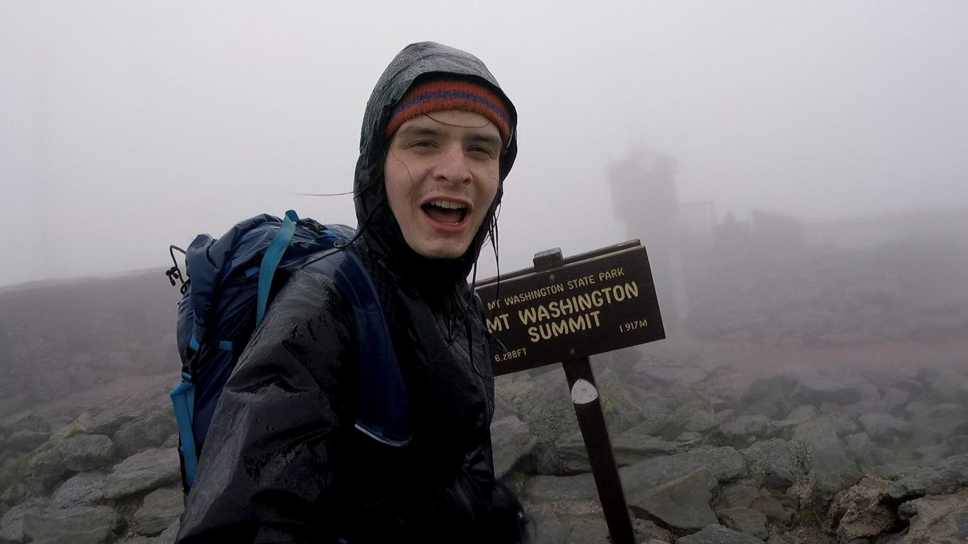 Standing atop summit of Agiocochook, AKA Mt. Washington, in the rain