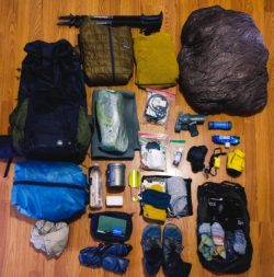 Gear photo with everything laid out on a hardwood floor